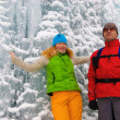 Couple backpackers and ice waterfall — Stock Photo #2677574