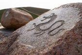 Dragon - primitive art draving on stone — Stock Photo