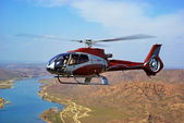 Helicopter on river in desert — Stock Photo