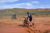 Bike race in desert mountains — Stock Photo