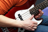 Play on guitar close-up — Stock Photo