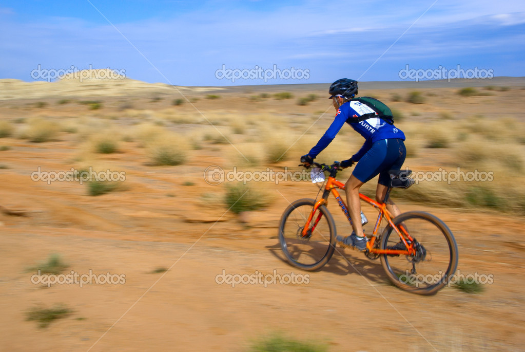 Speed motion mountain biker on desert  Stock Photo #2672987