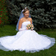 Stock Photo: Bride blonde sits on grass
