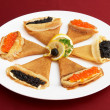 Pancakes with red and black roe — Stock Photo