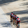 Stock Photo: Cycling team racing on velodrome