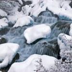 Winter mountain creek cascades during snowfall — Stock Photo #2689068