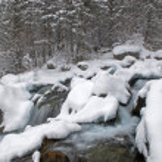 Winter mountain creek during snowfall — Stock Photo #2689200