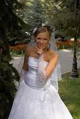 Merry blonde bride — Stock Photo