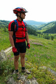 Mountain biker and rural landscape — Stok fotoğraf