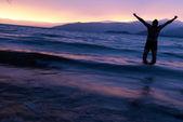 Man on the like at sunset — Stock Photo