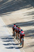 Cycling team racing on velodrome — Stock Photo