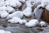 Winter mountain creek during snowfall — Stock Photo