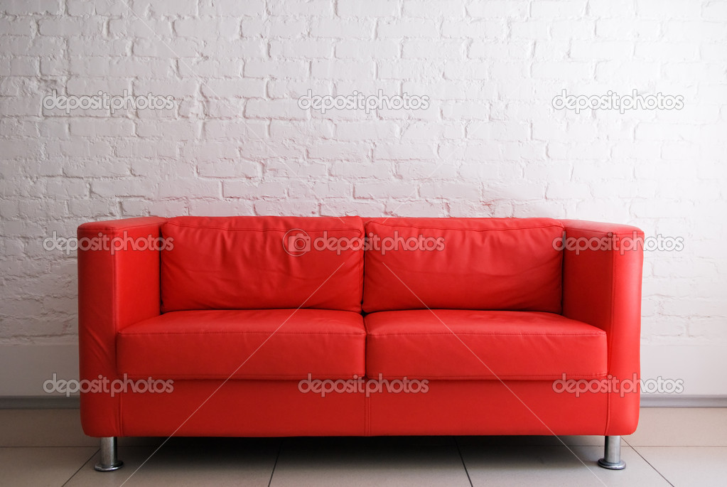 Red sofa and white brick wall stock photo petrichuk 2689411 Rotes sofa kiel