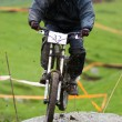 Biker jump on dirty downhill race — Stock Photo