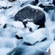 Cascades on a mountain river in winter - Stock Photo