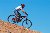 Mountain biker downhill — Stock Photo