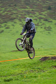 Extreme jump on downhill race — Stock Photo