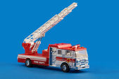 Fire dept car toy on blue — Stock Photo