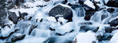 Cascades on a mountain river in winter — Stock Photo