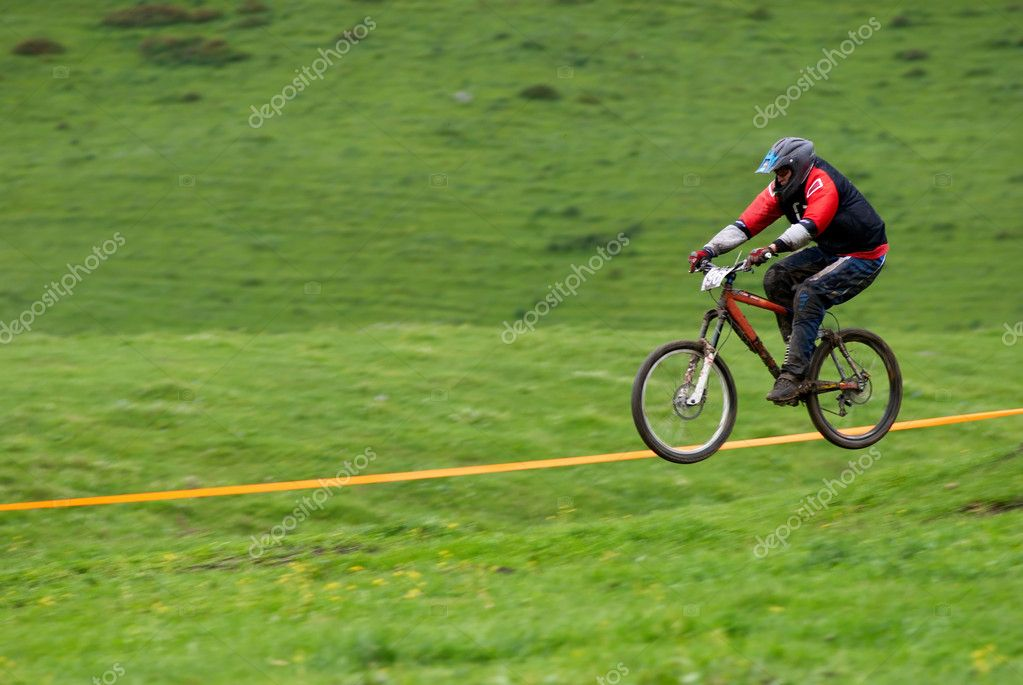 Blurred motion fly on downhill mountain bike race — Stock Photo #2692098