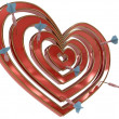 Dartboard heart with darts — Stock Photo