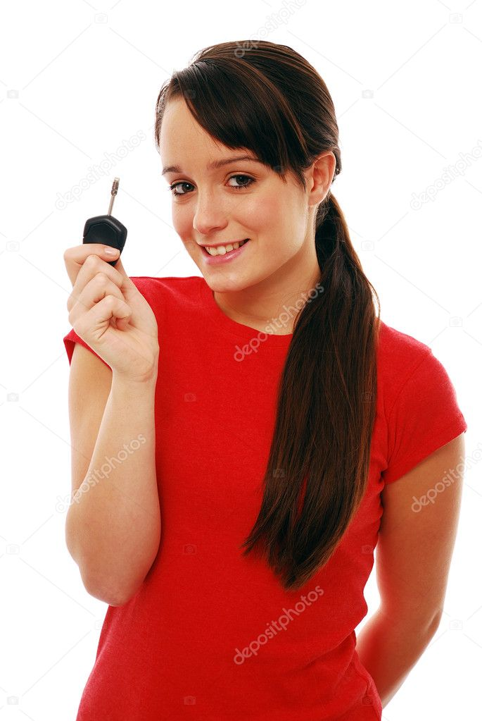 Beautiful girl holding car key isolated on white — Stock Photo #2595856