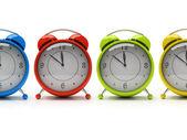 四个色彩缤纷的闹钟 — 图库照片