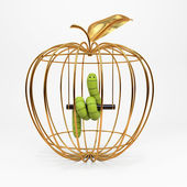 Green worm in the apple — Stock Photo