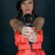 Hairdryer gun holding by a woman — Stock Photo #2638606