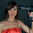 Hairdryer gun holding by a woman — Stock Photo #2638634
