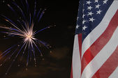 United States flag with fireworks — Stock Photo