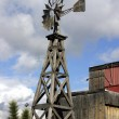 Old Wooden Windmill - Stock Photo