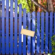 Blue Fenced Door with a Blank Sign — Stock Photo