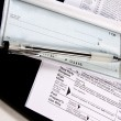 Stock Photo: Preparing Taxes - Check and Forms