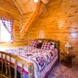 Stock Photo: Close up on a Bedroom in a Cabin
