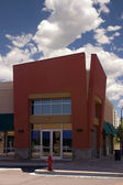 Strip mall - hoek winkel restaurant — Stockfoto