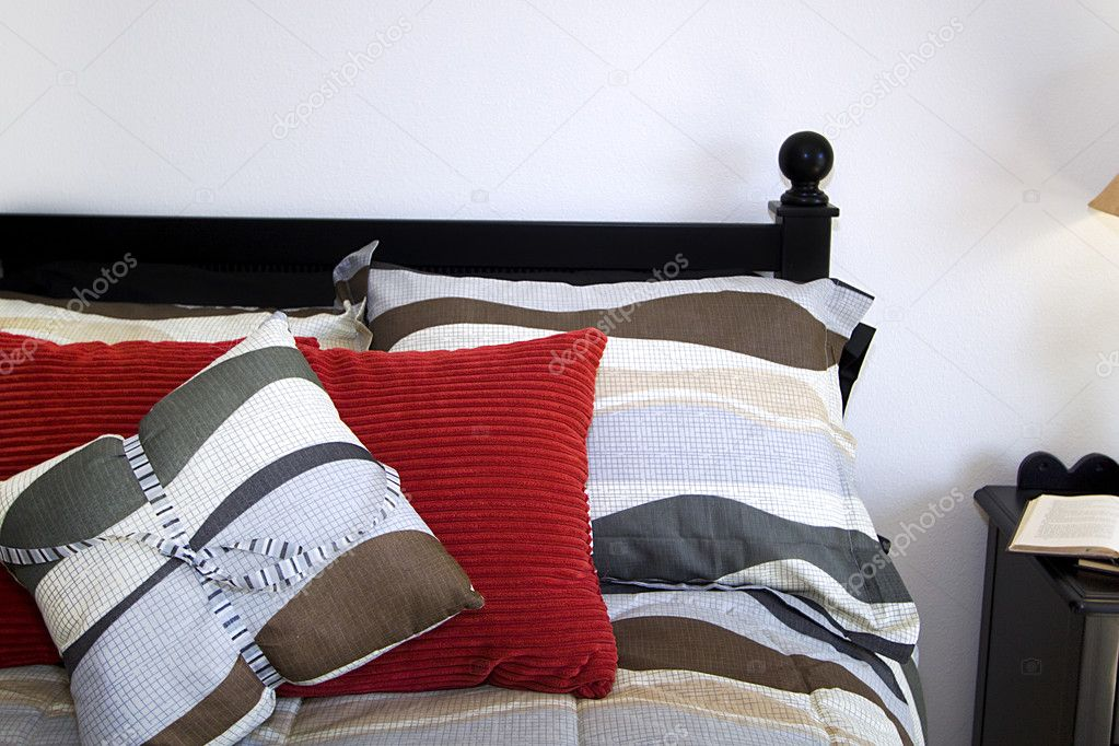 Close up on a bed in a bedroom — Stockfoto #2603040