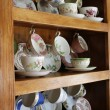 China Cabinet full of Cups — Stock Photo #2662034