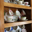 China Cabinet full of Cups — Stock Photo