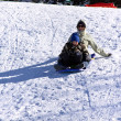 Mother and Son Sledding down the Hill — Stock Photo #2663525