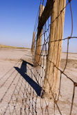 Wire and Wooden Fence Under Clear Skies — Stock Photo
