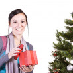 Beautiful Girl by the Christmas Tree — Stock Photo