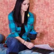 Teenager Drinking Coffee and Reading — Stock Photo #2692811