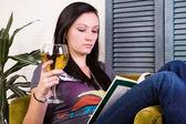 Cute Girl Drinking while Reading a Book — Foto de Stock