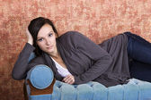 Bautiful Teenager on the couch — Stock Photo
