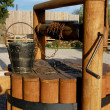 Old well with a bucket — Photo