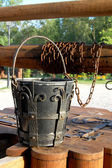 Old well with a bucket — Stock Photo