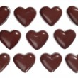 Heart-shaped dark chocolate candies — Stock Photo #2596465