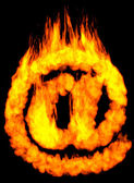 Burning E-mail Symbol AT — Stock Photo