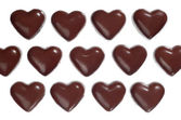 Heart-shaped dark chocolate candies — Stock Photo
